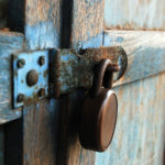 Rusty lock on wooden door