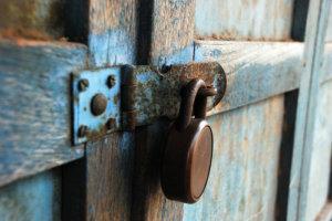 Rusty lock on wooden door