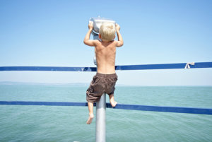 Young boy at pier viewfinder
